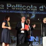 Nicoletta Ercole costumista premia il truccatore Luigi Rocchetti per la fictionIL NOME DELLA ROSA